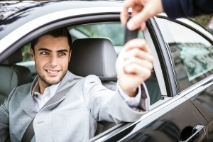 bigstock-Man-taking-car-key-41217067