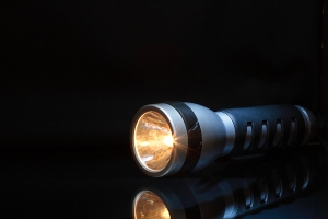bigstock-Flashlight-In-Dark-4983806